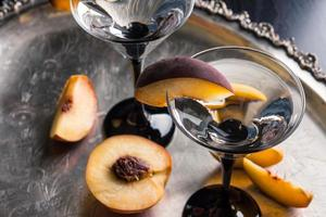 Vodka and martini with fresh peaches photo