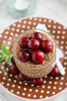 Chocolate tapioca pudding with cherries photo