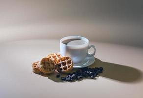 cup of coffee with milk and soft waffles.