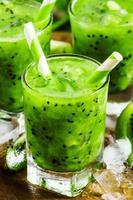 Fresh green juice with kiwi and ice