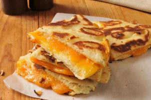 Grilled cheese sandwich on naan bread photo