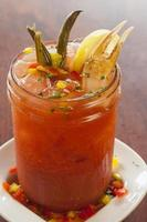 spicy bloody mary garnished with greenbeans and a crab claw
