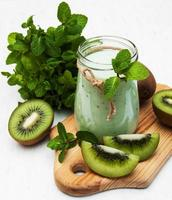 kiwi smoothie in glass photo