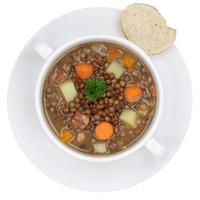 Lentil soup stew with lentils in bowl from above isolated