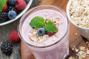delicious berry smoothies with oatmeal, close-up, top view