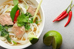Pho bo soup above view closeup photo