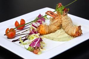 Dish with prawns and guacamole
