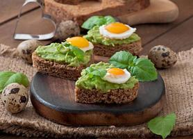 Sandwich with avocado paste and egg