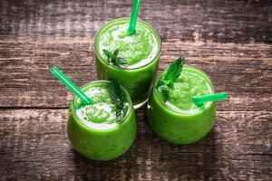 green Detox smoothie on wooden table photo