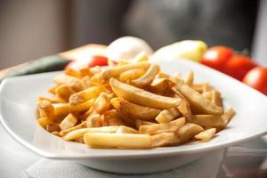Rolled meat with French fries photo