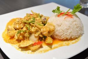 Rice with stir fried curry seafood