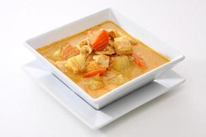 Square white bowl with chicken curry
