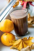 Glass of cocoa and tangerine