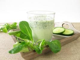 Green smoothie with corn salad and cucumber photo