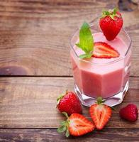 Drink smoothies summer strawberry, blackberry, raspberry on wooden table