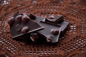 Pieces of chocolate on a crocheted napkin photo
