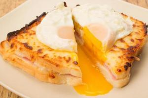 Croque madame toasted sandwich cut in half photo