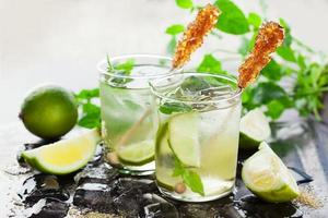 Lemonade with fresh lemon and lime photo