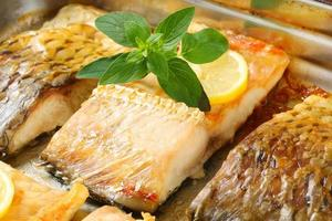 Oven roasted carp fillets photo