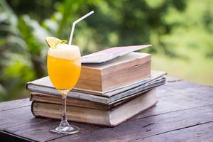 Orange juice blend with old book