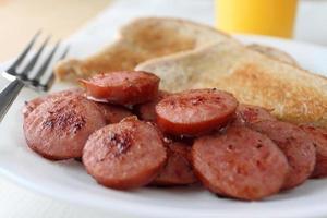 Sliced and fried kielbasa sausage photo