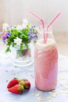 Strawberry smoothie freshly made in a jar