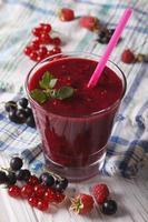 delicious and healthy smoothies with fresh berries closeup. Vert