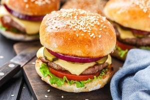 Delicious burger on wooden board photo