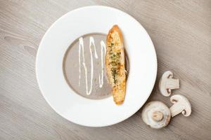Vegetarian mushroom cream soup puree with baked bread cheese