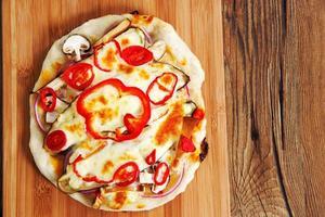 Home made vegeterian margarita pizza on table