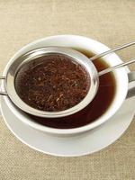 Rooibos tea in tea strainer