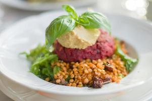 Beetroot, tofu, carrot and chickpea patty served