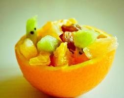 Fruits in orange peel photo