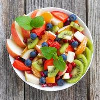 Fruit and berry salad, top view, close-up