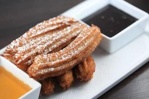 Dessert player with churros and dipping sauce