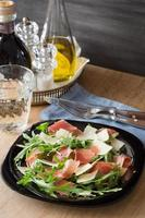 Arugula salad with shaved parmesan and prosciutto crudo photo