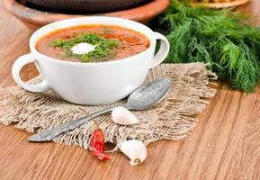 Borsch, soup from a beet and cabbage with tomato sauce. photo
