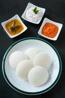 Idly (idli) with coconut tomato chutney, sambar photo