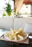 Deep fried eggplant in tempura coating photo