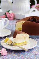 Elegant chocolate souffle cake covered with chocolate velor, photo