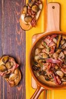 Fried mushrooms with bacon, garlic, rosemary photo