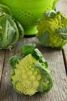 Romanesco cabbage on wooden background. photo