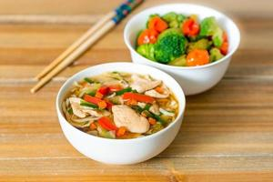 Bowls of Asian soup noodles photo