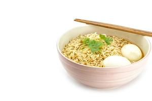 Noodles with boiled eggs in bowl and chopsticks