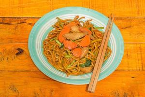 fried noodle on wooden background