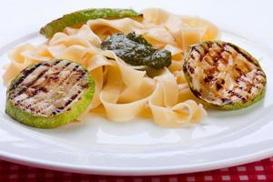 Grilled zuccini round with noodles photo