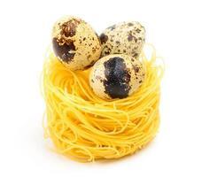 Italian egg pasta nest on white background.