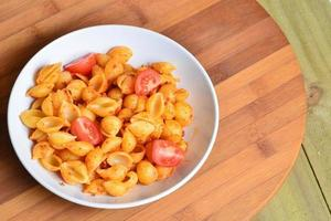 Image of tasty pasta with tomato pesto photo