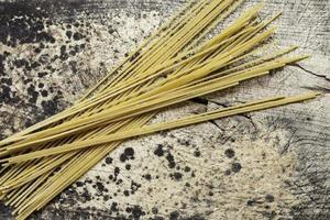 whole wheat pasta on a wooden table photo