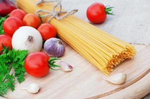 Pasta spaghetti and fresh vegetables photo